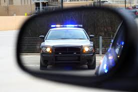 Cop-Car-Reflection-In-Side-Mirror